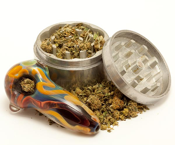 Cannabis accessories - grinder, pipe, bud